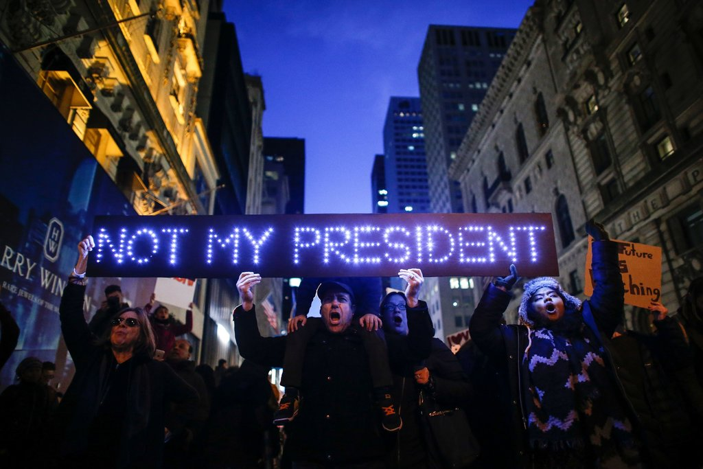 People gathered outside Trump Tower to protest the election of Donald J. Trump.Photo by Kena Betancur.