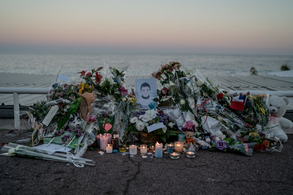 A memorial to a child killed during an attack on Bastille Day, when a man in a cargo truck ran over hundreds of people. Photo by Andrew Testa.