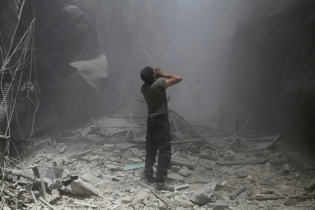 A Syrian man after a reported airstrike by Syrian government forces in Bustan al-Qasr, a rebel-held neighbourhood. Photo by Baraa Al-Halabi.