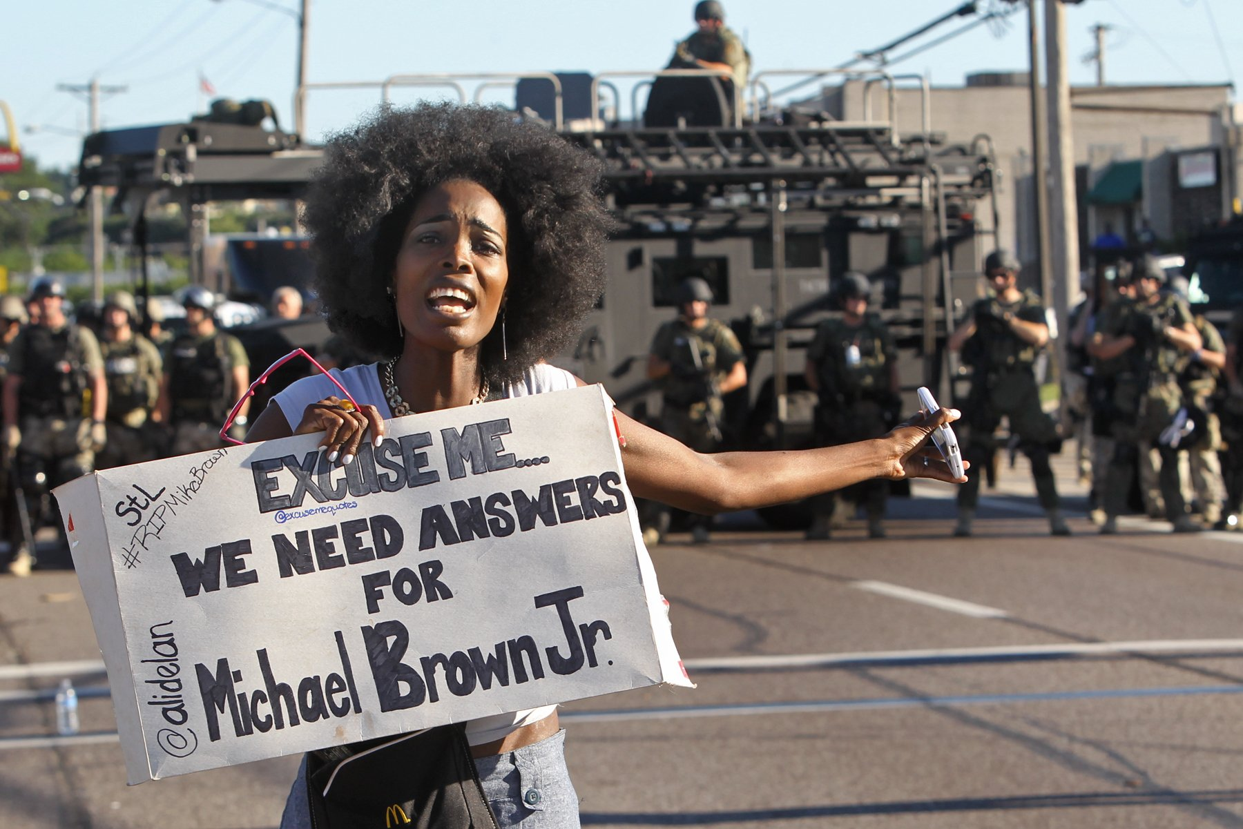 A protester shouts as she moved down W. Florissant Avenue away from the line of riot police in Ferguson on Wednesday, Aug. 13, 2014.Photo by J.B. Forbes.