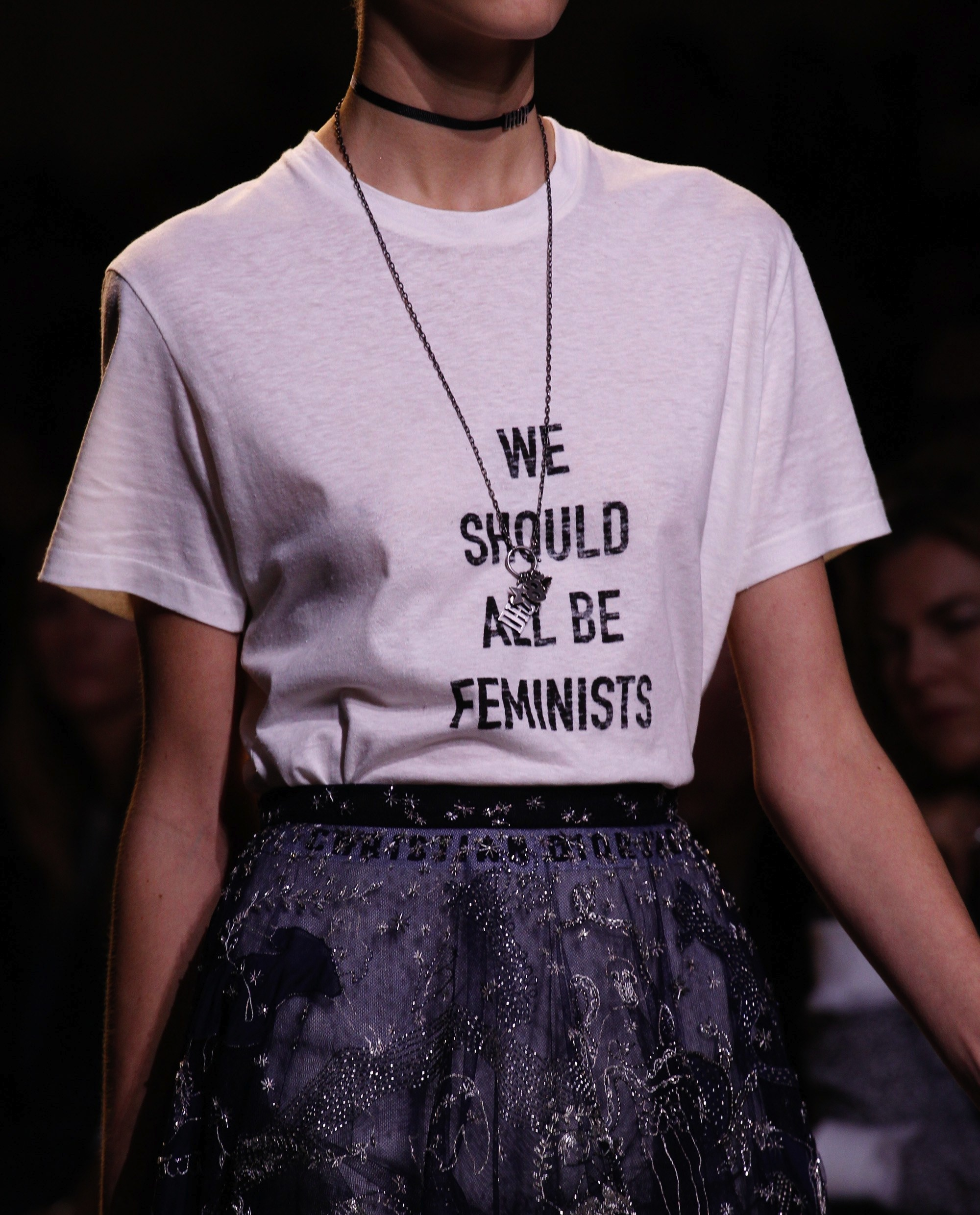 "A t-shirt with the words "" We Should All Be Feminists "" by Maria Grazia Chiuri for Christian Dior's SS17 collection. Photo source:  Vogue  Runway."