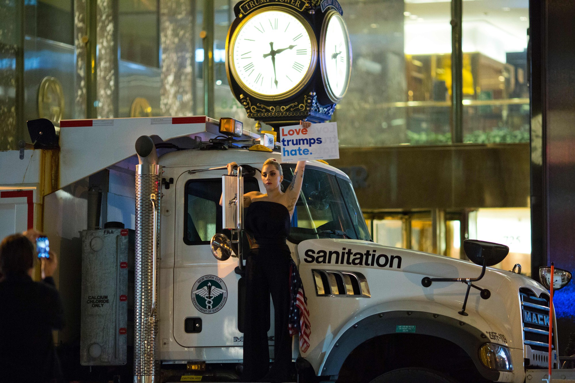Lady Gaga stages a protest against Donald Trump on a sanitation truck outside Trump Tower in New York City after midnight on election day November 9, 2016. Photo source: AFP.
