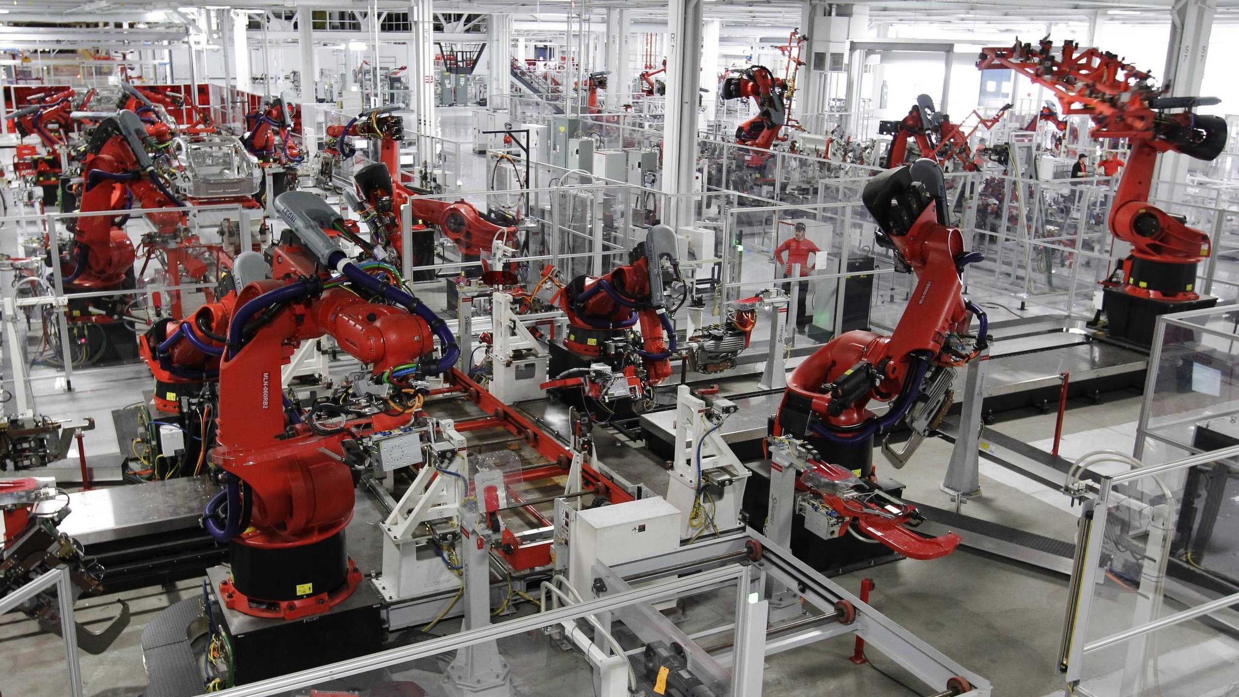 Robots assemble a Tesla Model S at the Tesla factory in Fremont, California. Photo by Paul Sakuma/ AP .