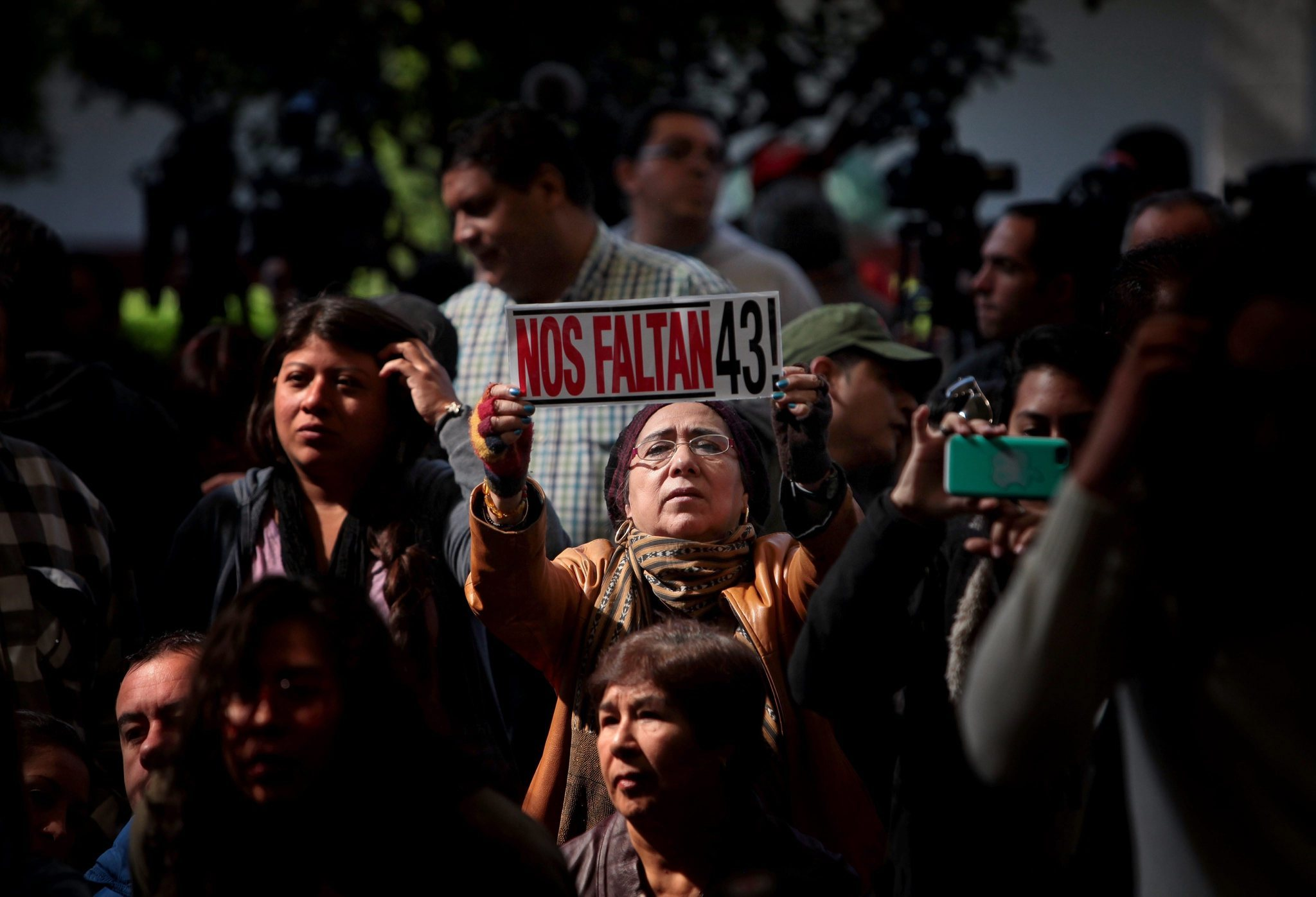 "A woman's banner reads ""We Are Missing 43!"" at a presentation in Mexico City on Sunday to relatives of 43 missing Mexican college students from a school in Ayotzinapa. Photo by Sashenka Gutierrez for EPA."