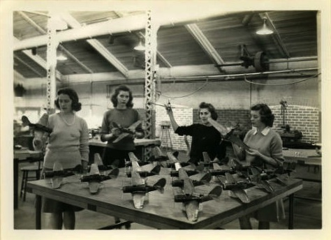 Four cadettes with their metal model planes, 1943. Photo source: Iowa State University Archive.