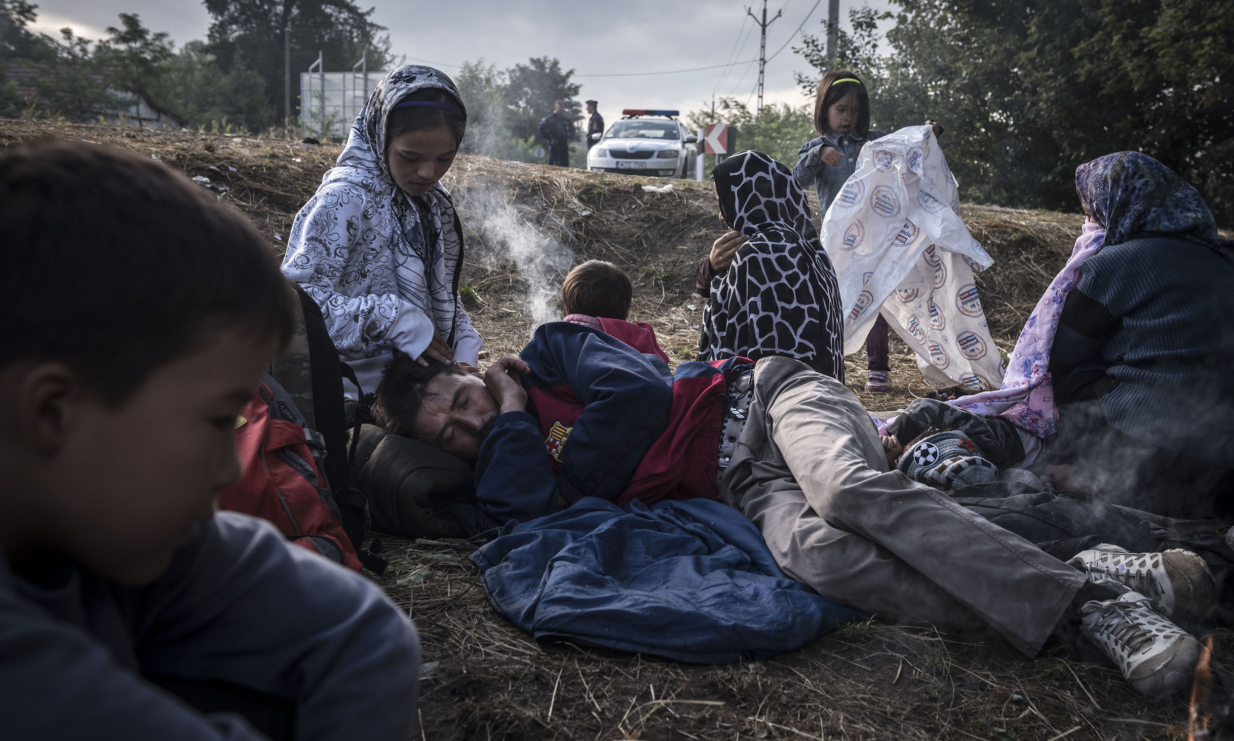 Migrants being detained by Hungarian police after crossing the Serbia-Hungary border outside Asotthalom, Hungary. Photo by Sergey Ponomarev for  The New York Times .