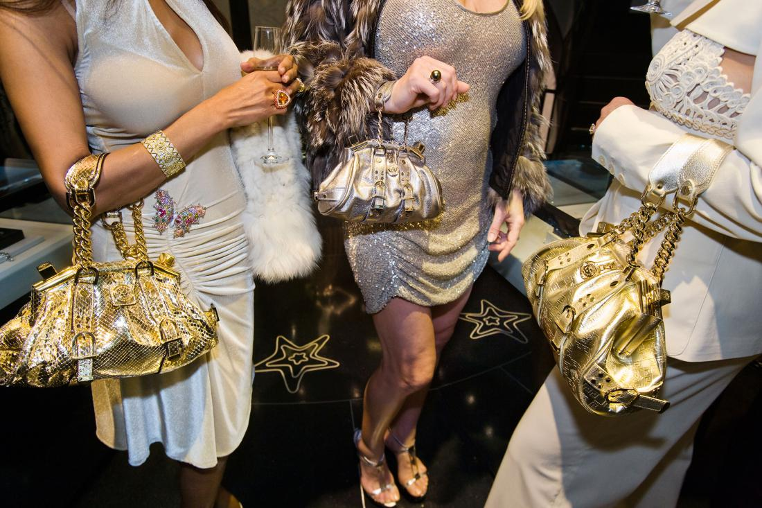 Jackie and friends with Versace handbags at a private opening at the Versace store, Beverly Hills, California, 2007 by Lauren Greenfield.