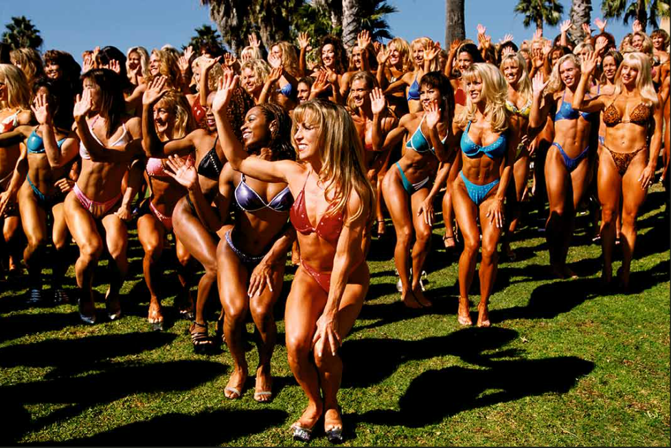 Contestants in the Fitness America competition pose for a photograph, Redondo Beach, California, from series Girl Culture by Lauren Greenfield.