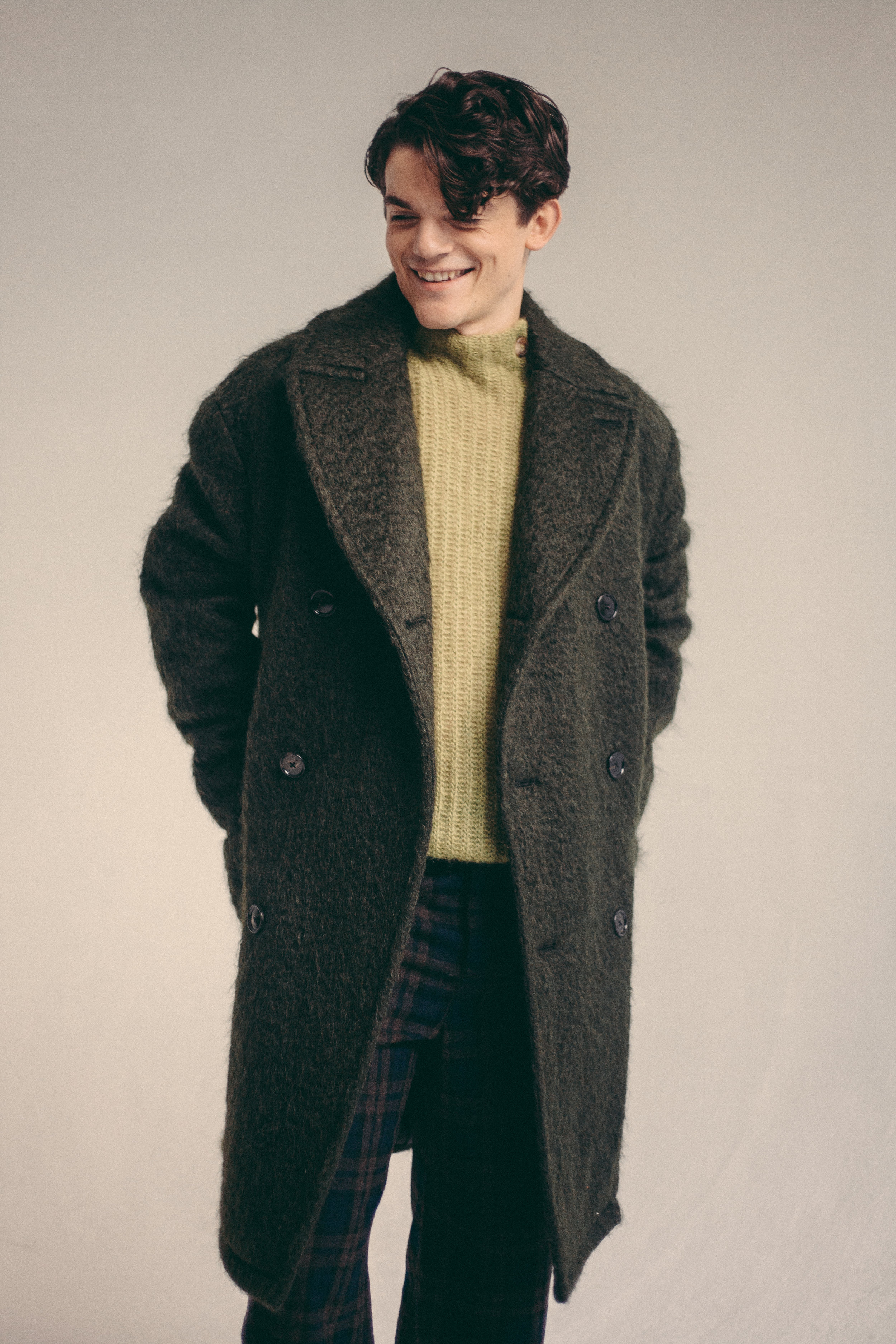 Trousers by   Loewe  , Jumper and Coat by   Hermès .