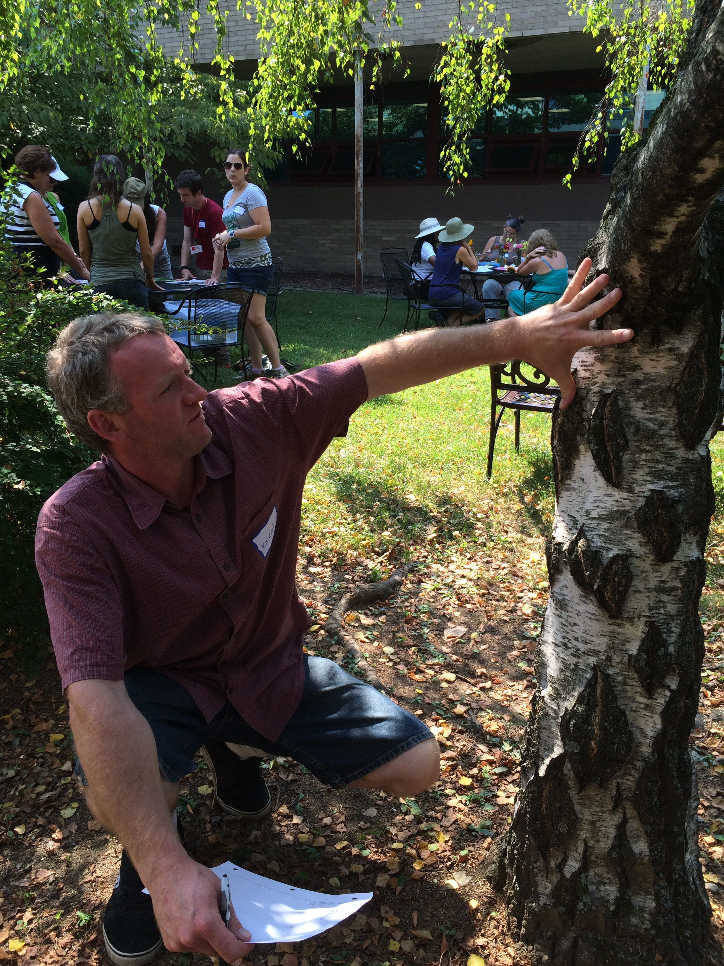 Kieran Hales from the  Primrose Hill School  measures a tree using hand spans to demonstrate a lesson from  Math in the Garden .