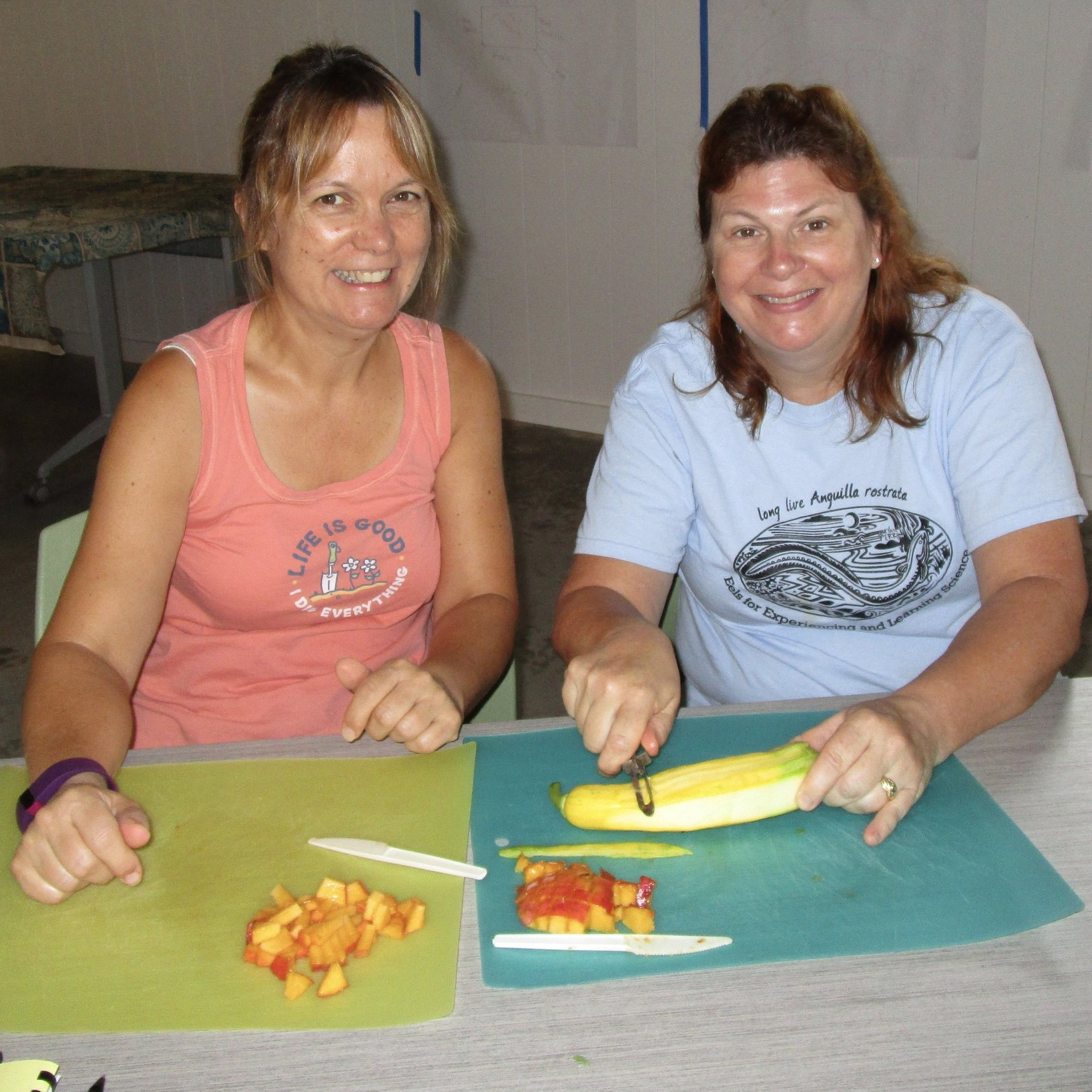 Suzi (left) and Mary make squash ribbons to add to the kale salad.