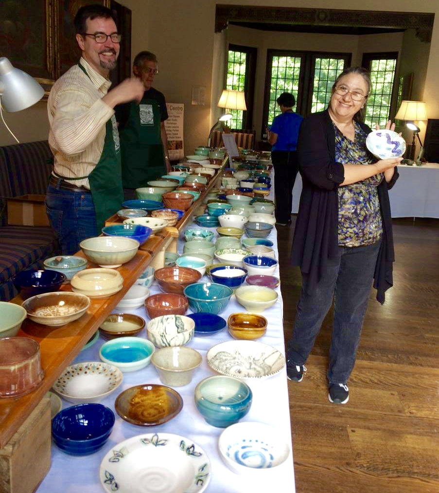 Karl and Cathy display the first round of bowls from which attendees can select.