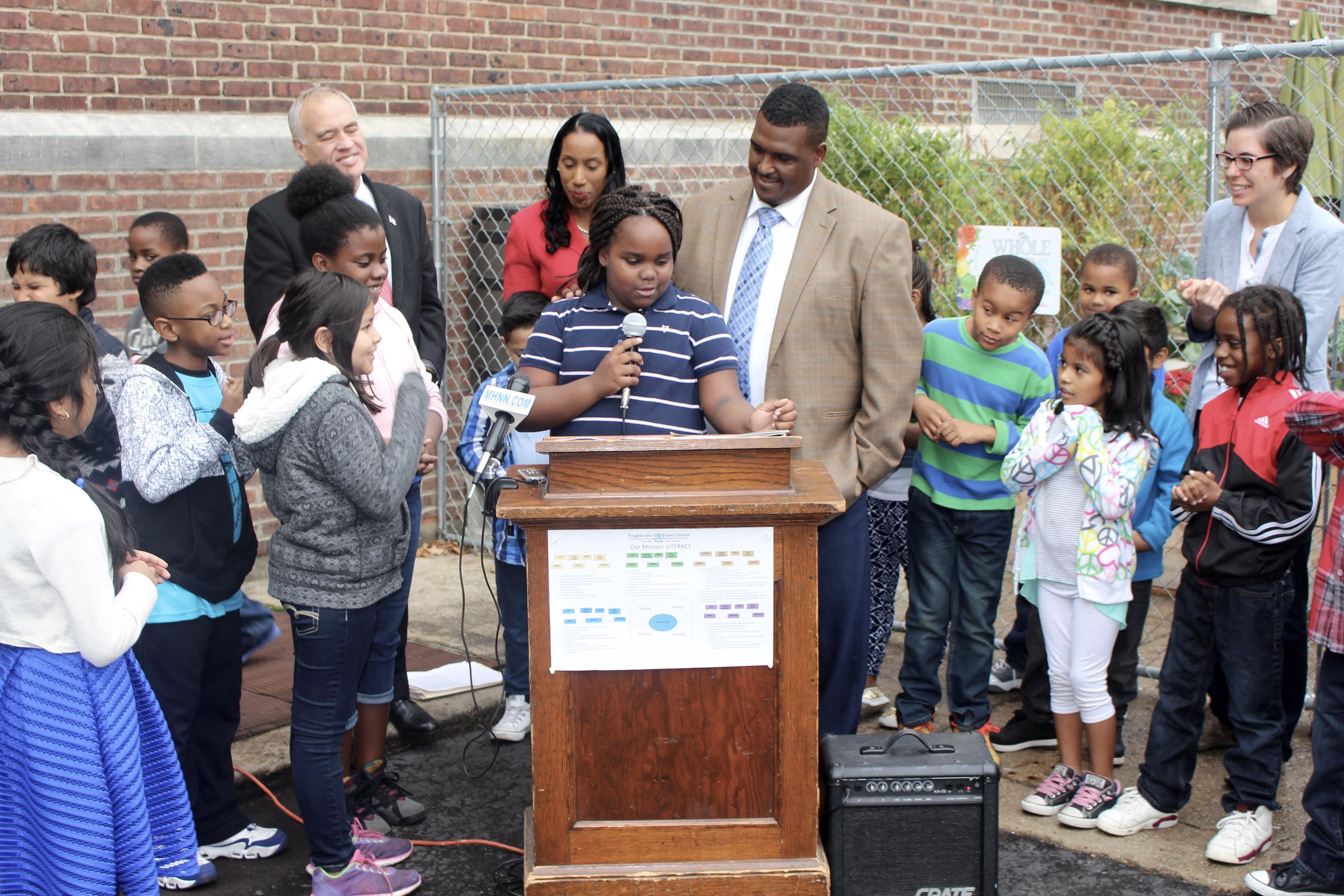 A 4th grader at Clinton School talks about building the school garden at the Comptroller's press conference.