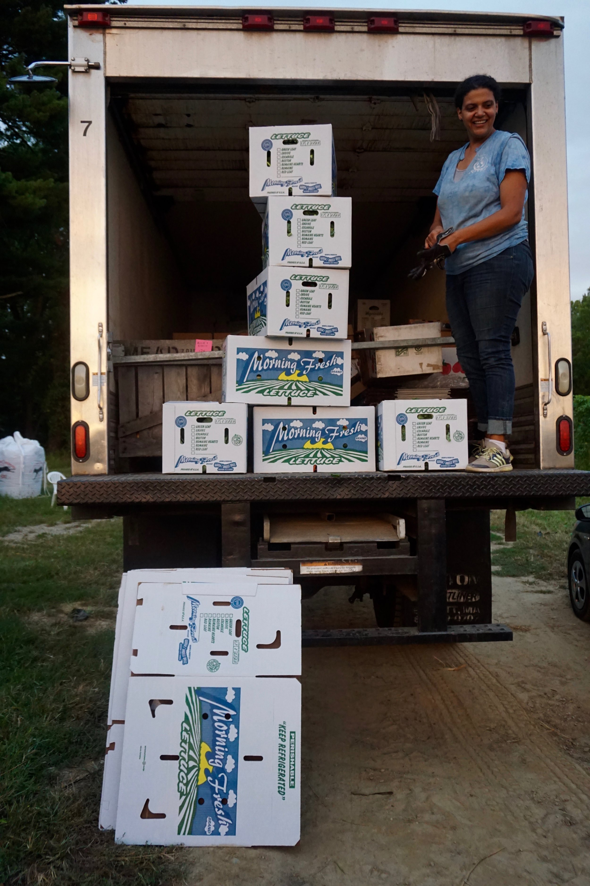 """Photo credit: Eilif Ronning, PFP Media Intern Stiles stands on her """"Gleanmobile"""" with fresh gleaned greens ready for delivery"""