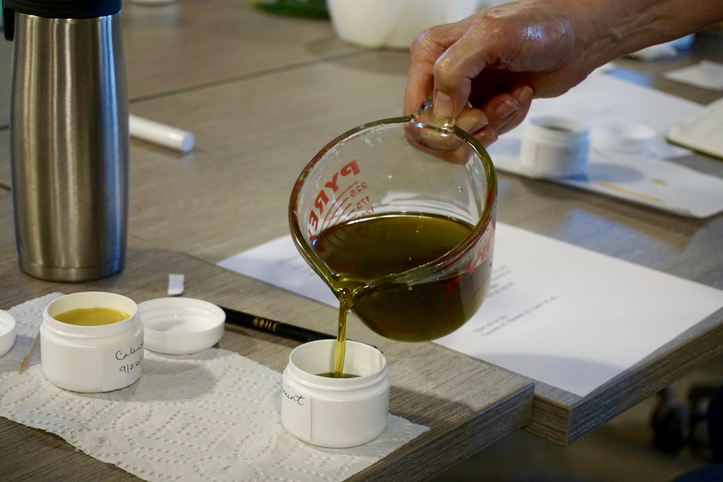 Above: Comfrey salve being poured into a container