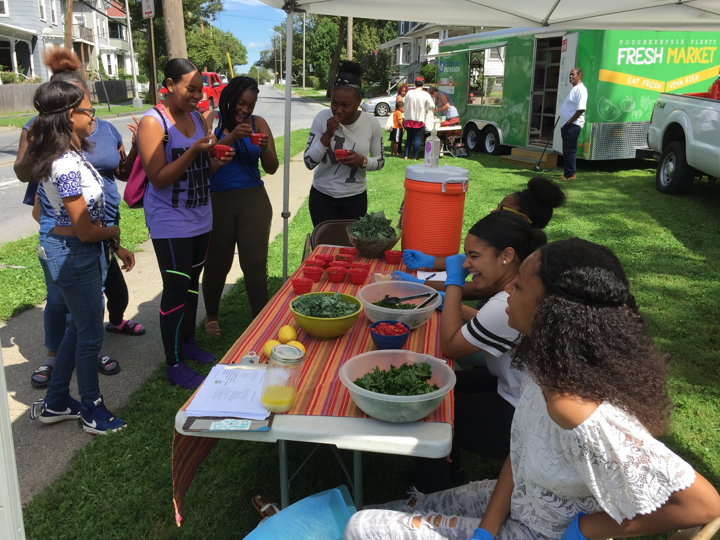 Teen interns get their peers excited about kale salad at Dutchess Outreach's Mobile Fresh Market.