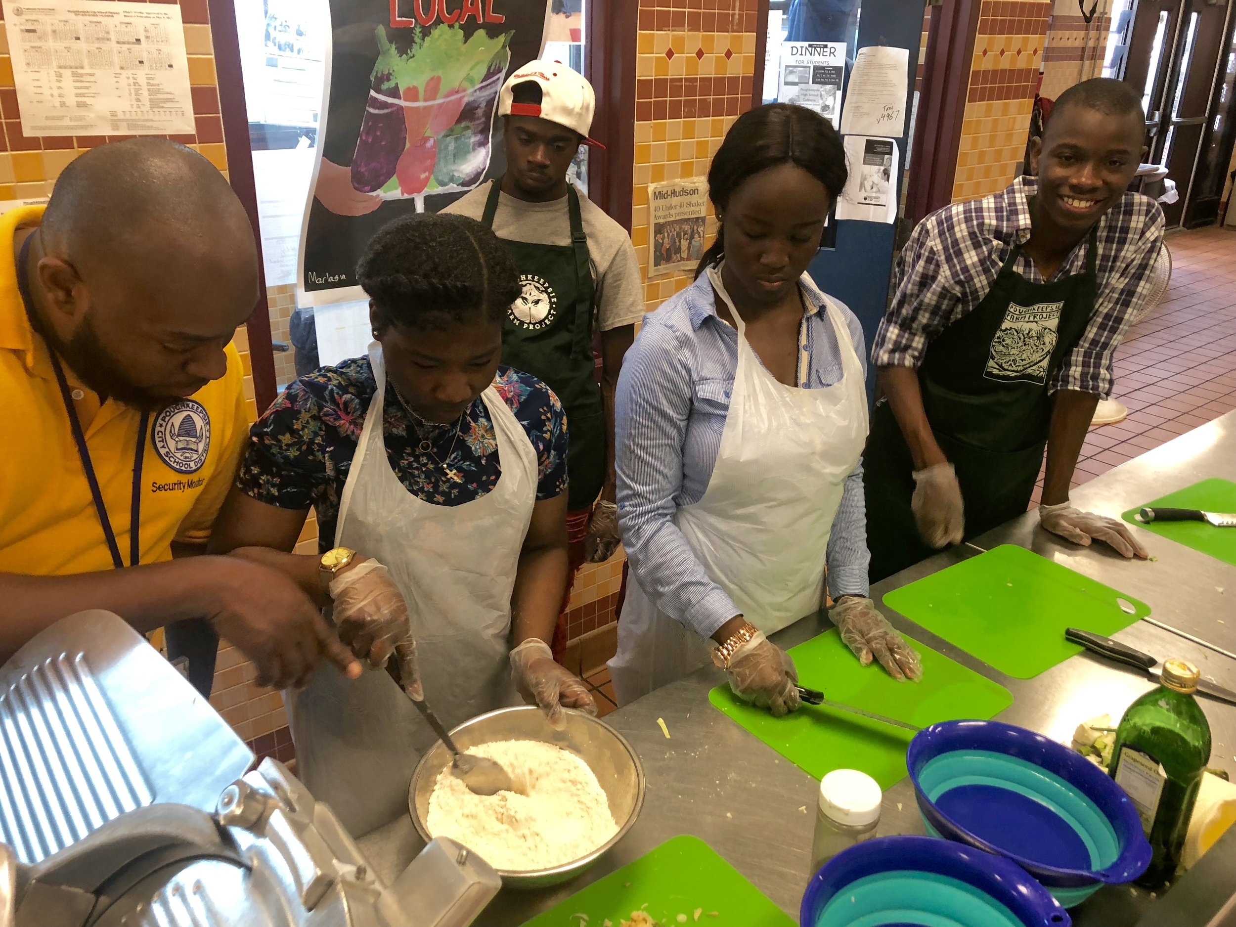 Chef Key and Chef Dave lead cooking workshops for teens at Poughkeepsie High School.