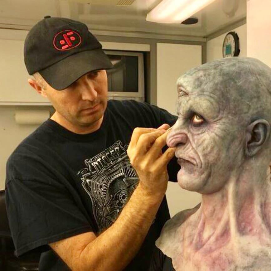 Clinton Wayne applying makeup on Stuntman Brady Romberg for Season 6 of Grimm.