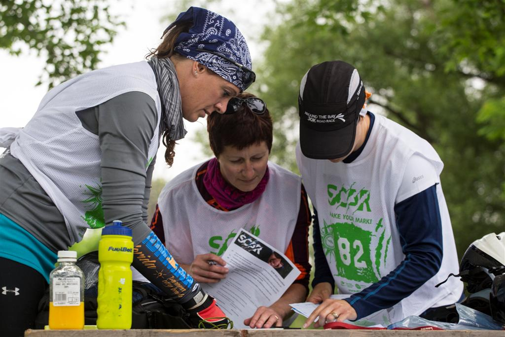Racers discussing route choices during the 2015 South Coast Adventure Race.