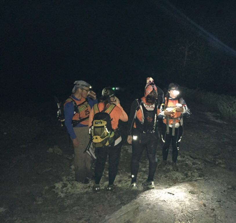 The Speed Bunnies refueling in the dark hours of Wilderness Traverse, where they were the only female team to complete the course.