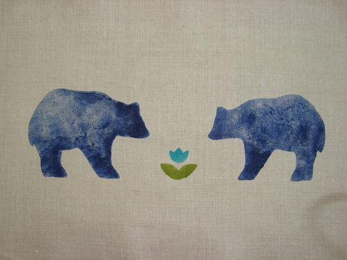 """A pair of Cal bears enjoying the first flower of spring. The motif is in blue, teal and bright green on a Classic Cotton - Dove roller shade. The Cal Bear stencil is 13"""" wide. $42.00 per motif."""