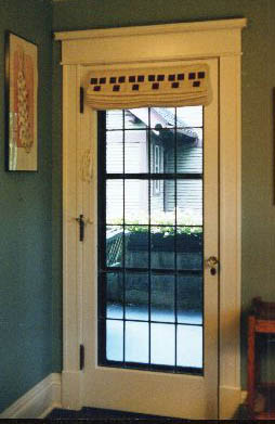 Here is an outside mounted standard shade on a door with the Three Square stencil in mahogany.