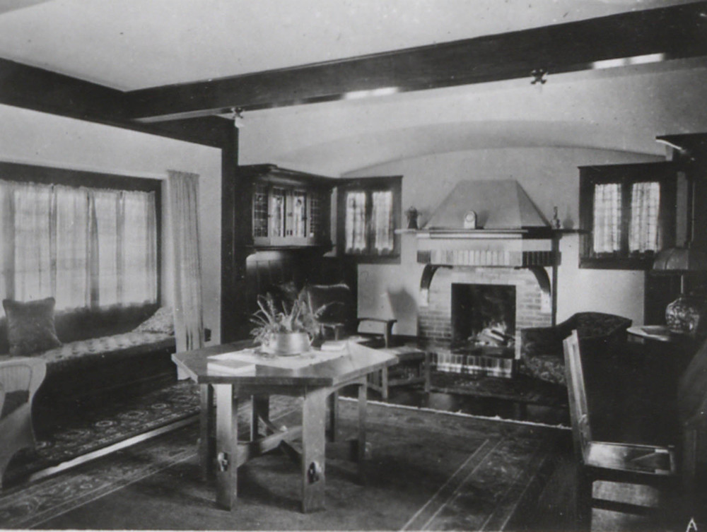 Above, a window seat with a box cushion can be seen in this vintage Arts & Crafts interior.
