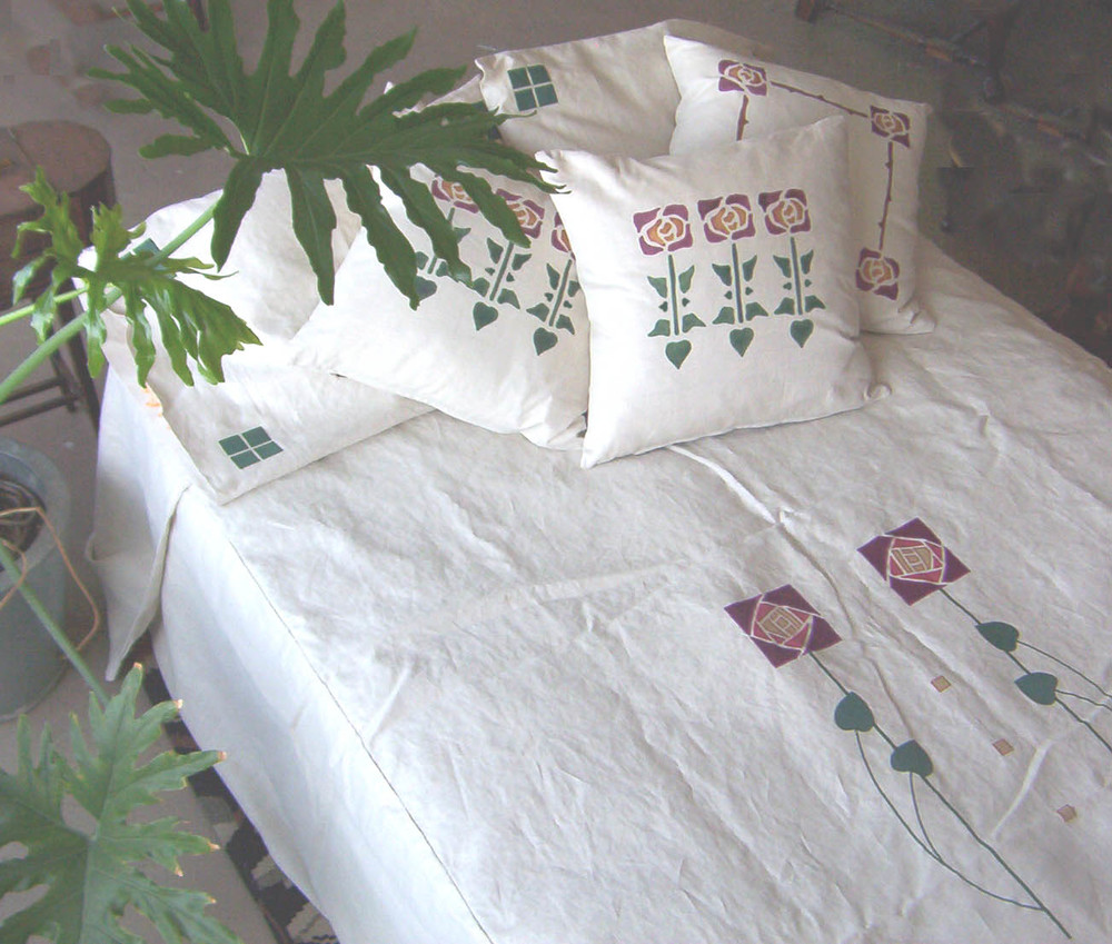 Custom Macintosh applique on white pillows and bedspread in dark red, forest and antique gold.
