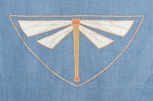 Dragonfly  : an Arts & Crafts mascot, shown here in sage, tangerine and antique gold on wedgewood custom linen. Body of dragonfly is 8 inches long, $40 per motif.