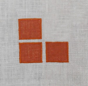 Three Square:   sometimes the simplest idea is the best. These three squares of color, appliqued at the inside corner of a pair of curtains or at each corner of a single panel might be just enough accent for your room. Each square is 1 1/4 inches. Also available as a stencil design.   (3 inches x 3 inches) $20.00 per motif.
