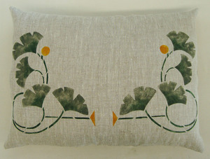 """Ginkgo Corner :   At right. Shown with two on a pillow in forest & antique gold on oatmeal linen, sideways to how we normally position it...but quite nice! About 12 1/2"""" wide x 12"""" high as shown here. Available as a template. $40.00 per motif."""