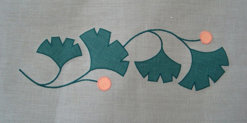 "Gingko Border:   the charming geometric shape of the ginkgo leaf has always been a popular Arts & Crafts motif. Combine with the Corner Motif for an elegant finish at the leading edge of your curtains. Shown here in forest and tangerine, 7"" wide (per repeat) x 4 1/2"" high per motif, $40.00 per repeat of four"