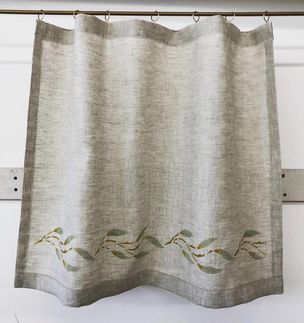 This curtain with cafe rings has a Small Willow stencil in sage and antique gold. Fabric is Handkerchief Linen - Natural.