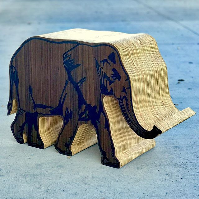 Elephant stool or side table with useful trunk for holding a book or iPad. #elephantart #sidetable #stool #ottoman #ottomanart #funfurniture #furnitureart #artfulartifacts #artfuldecor #homedecor #playroom #cncart #longbeach #socal #madeincalifornia #modernmaker #animalart