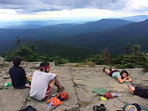 Sitting and snacking on top of a mountain in Vermont