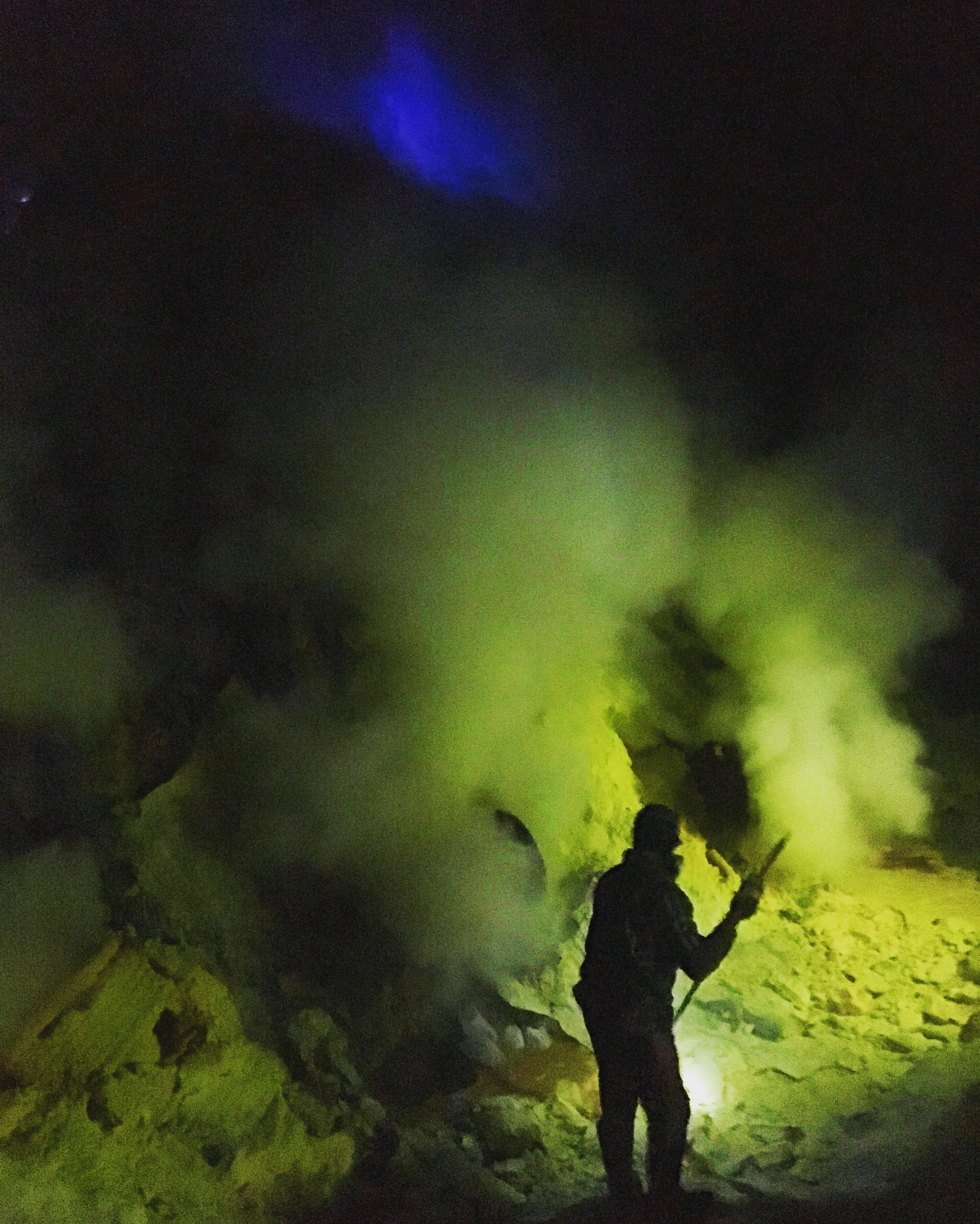 A miner beneath the blue flame