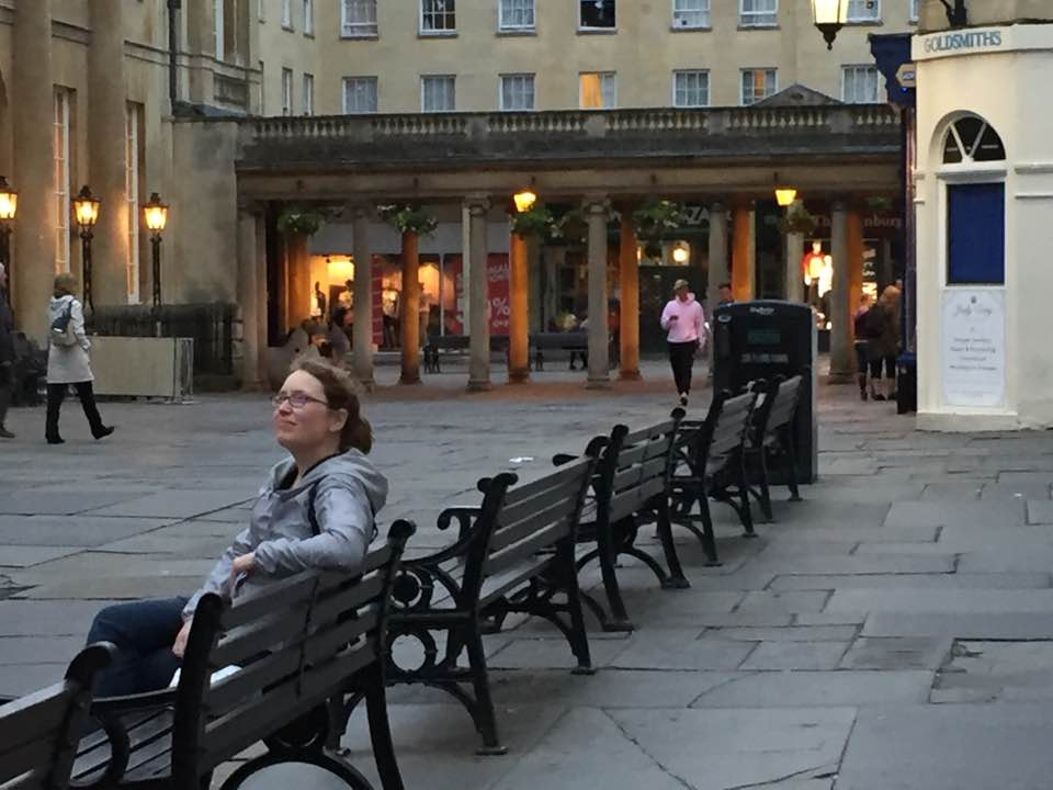 Julie Gard watches night approach the Bath abbey.