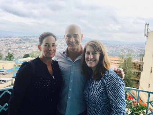 The PeakChange Team at Jibu's Kigali HQ. Jim Davidson, Melanie Davidson, and Emily Winslow are all smiles. Check out that view!