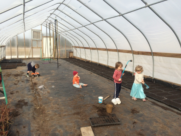Turnip Rock and Steady Hand kids as the greenhouse gets filled up with seeded flats waiting to GROW