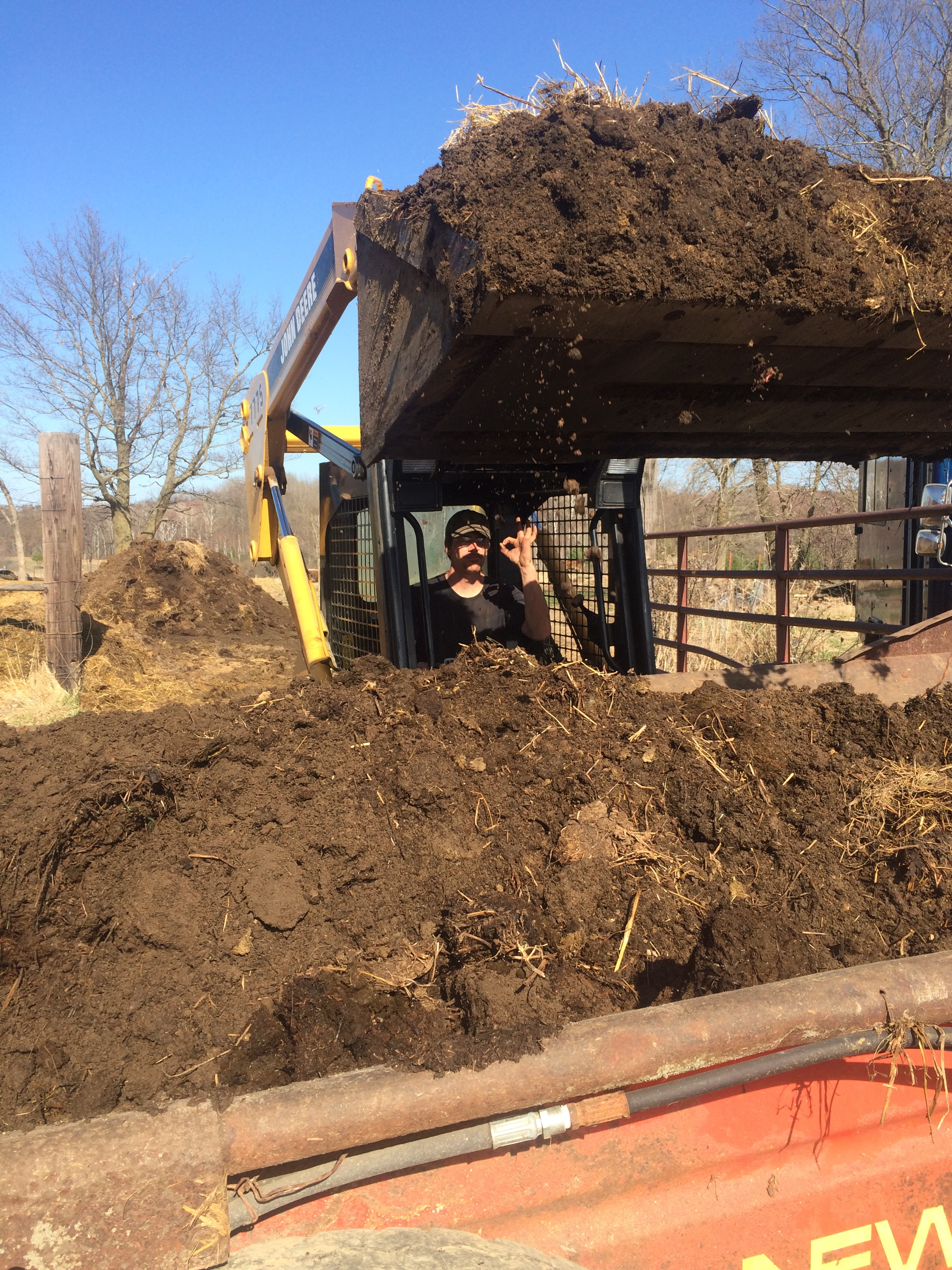 Farmer Josh moving our farm based fertility to the compost pile.
