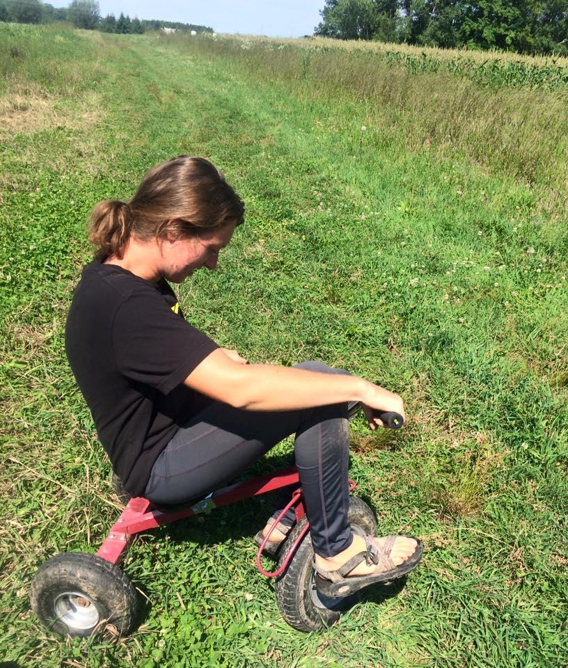 Farm fun! Kelsie trying out Otto's trike