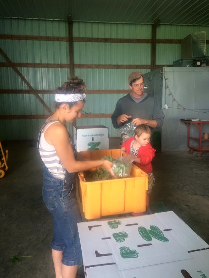 Hannah, Josh, and Sadie bagging it up