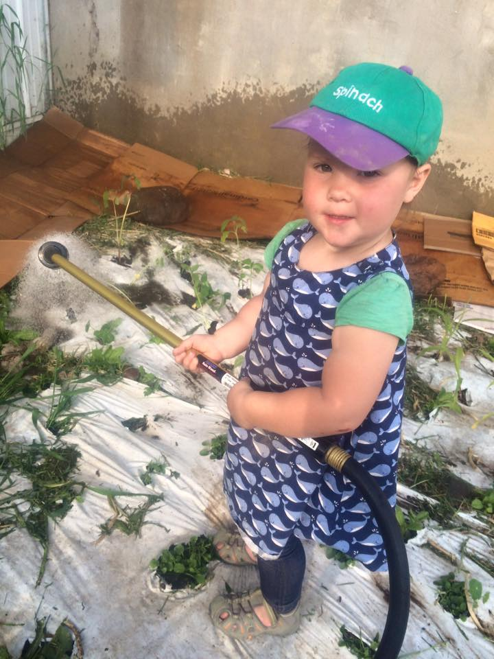 Sadie working in the kid garden