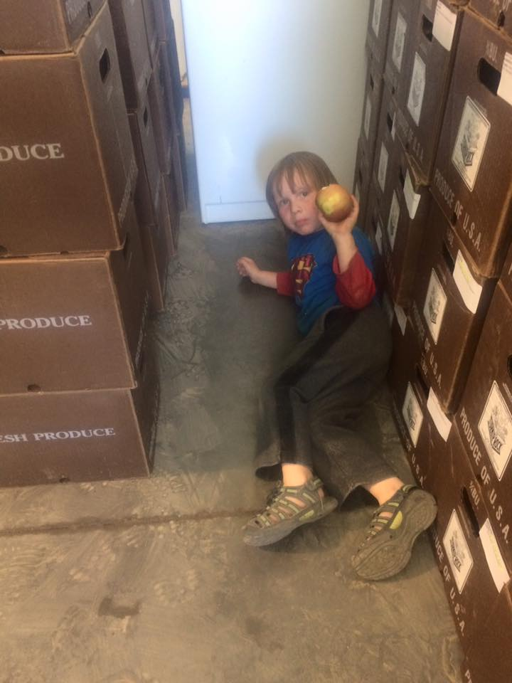 Otto taking a break during box packing after a lot of harvesting