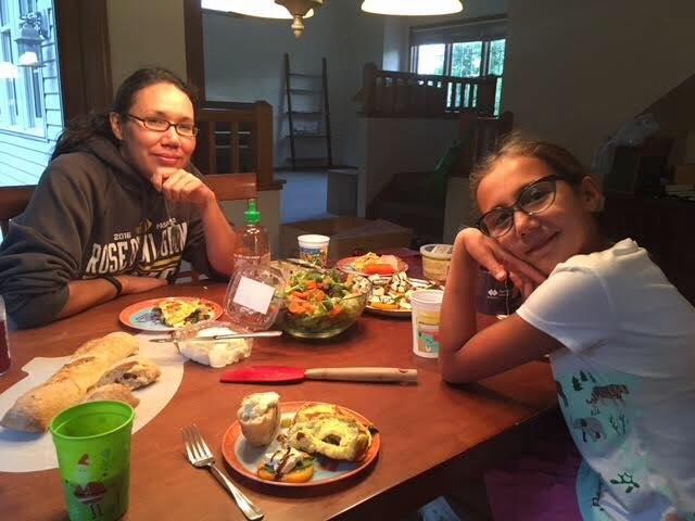 CSA members enjoying a beautiful veggie filled dinner!