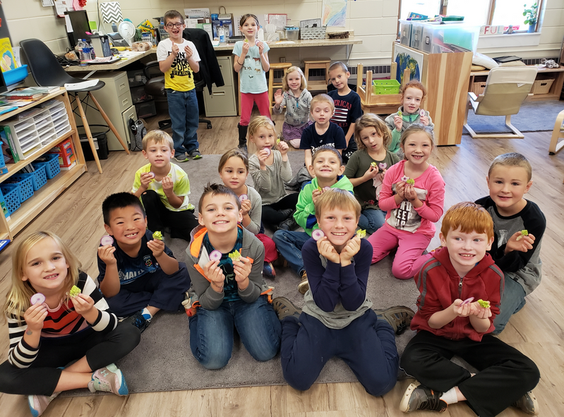 Otto brought Romanesco and Purple Diakon for his classmates to taste at school.  It was a hit with the class so much that the head of the cafeteria is going to get enough for the whole school to get to taste it!  Fractalflower all around!