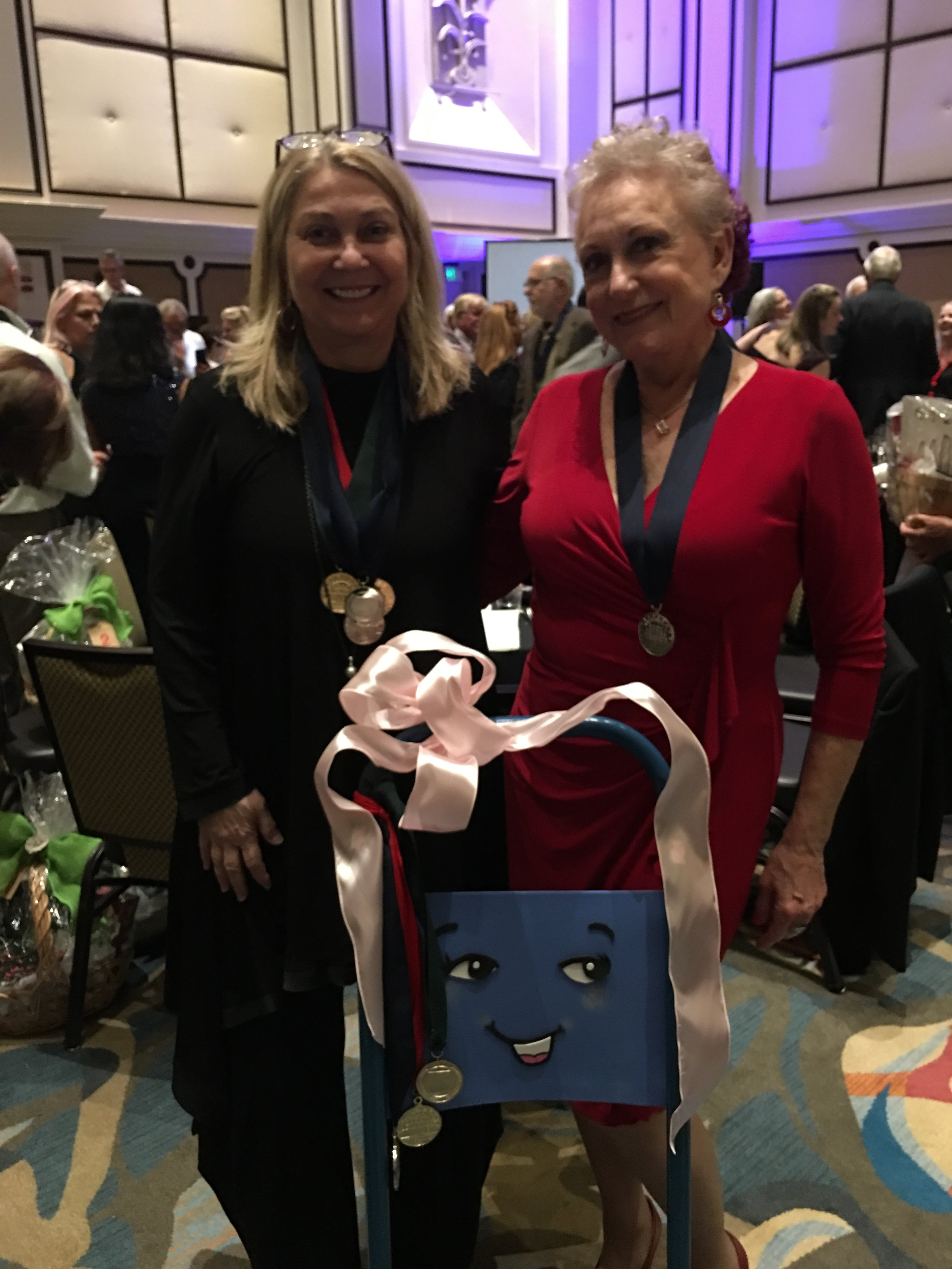 Kay Whitehouse joins Jayne Rose-Vallee for a pose with Dolly the Handcart!