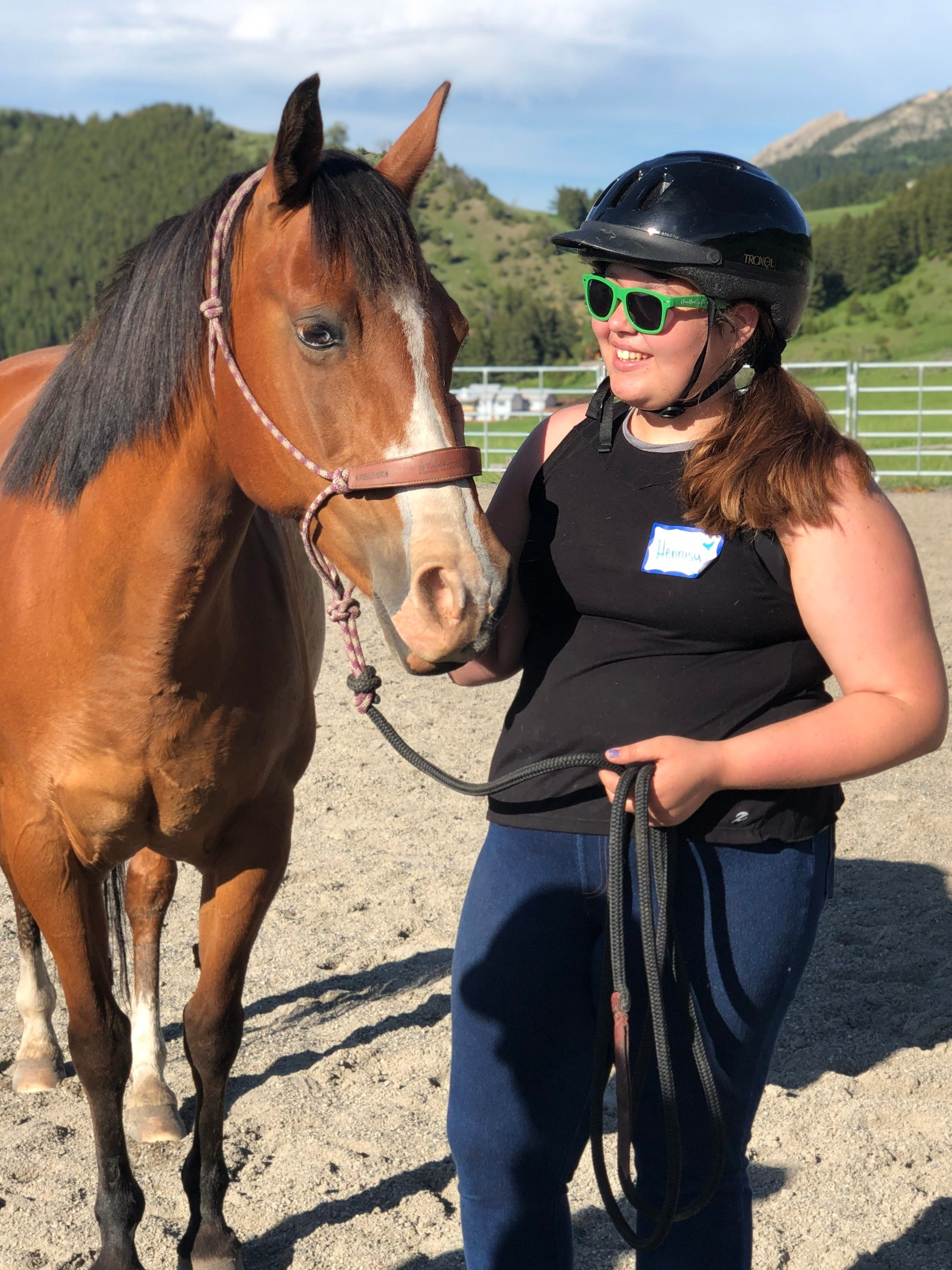 Ella makes a new friend with her partner from  Windhorse Equine Learning.
