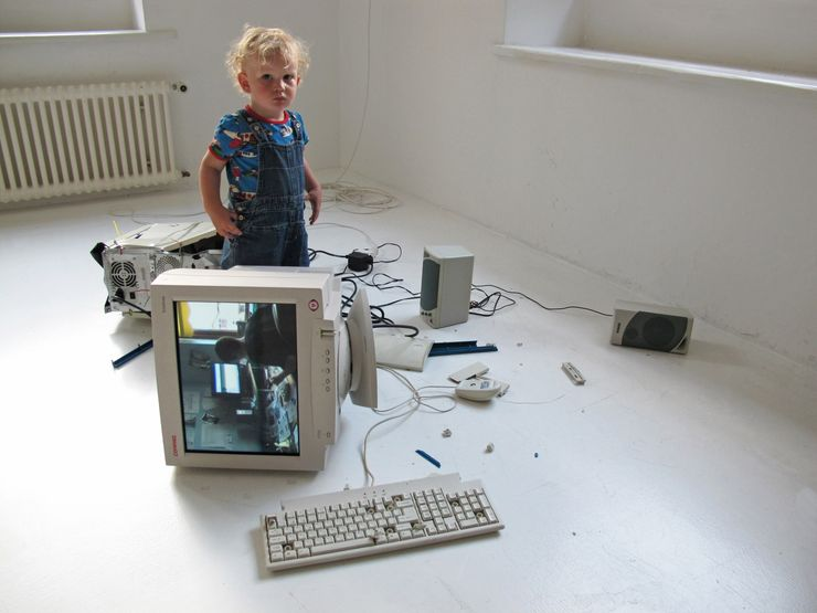 Eva and Franco Mattes,My Generation,2010. Video (13 minutes, 18 seconds), broken computer tower, CRT monitor, loudspeakers, keyboard, mouse, and various cables; overall dimensions variable. Installation view, Plugin, Basel.Collection of Alain Servais.