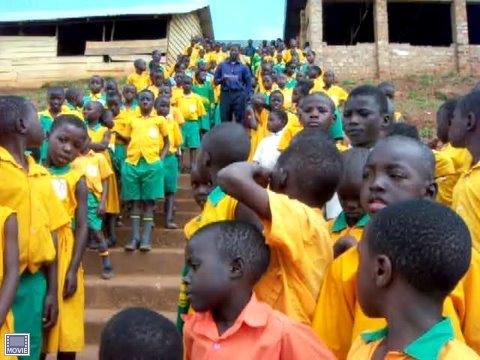 kids in uniforms on path.JPG